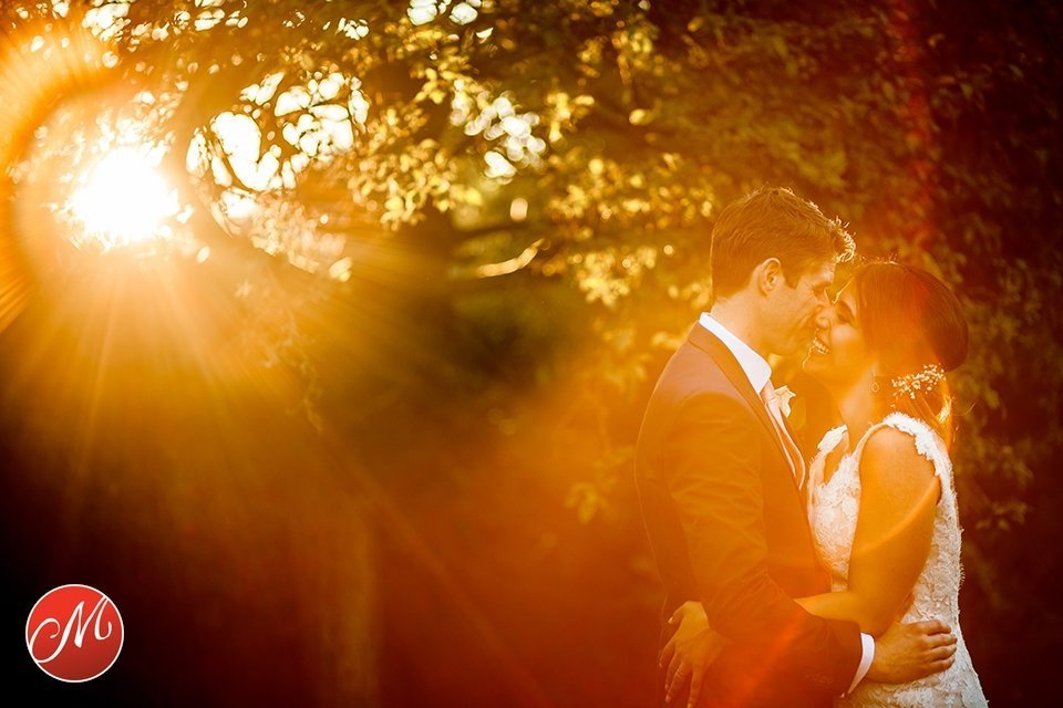 Romantic sunset wedding photo